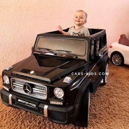 Электромобиль Mercedes-Benz G65 AMG белый (усиленный аккумулятор, кожа, резина, пульт, музыка, глянцевая покраска)